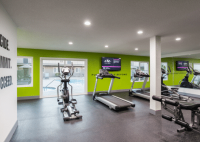 fitness room with treadmills and cycle machines