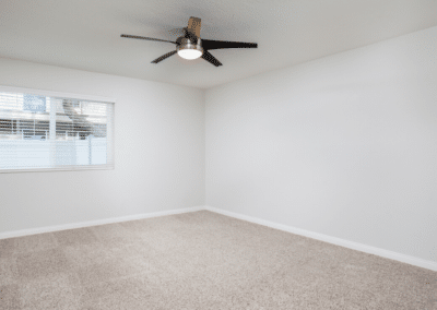 Carpeted Room with Ceiling and Window blinds